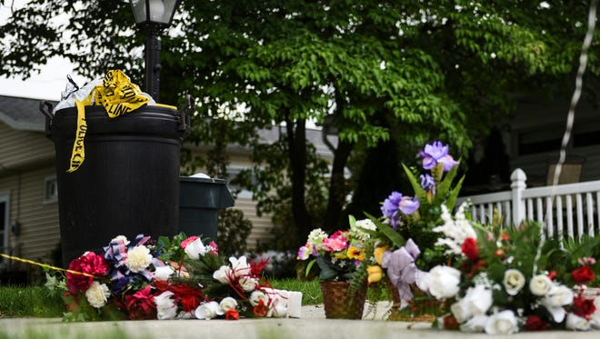 A memorial of flowers and balloons is set up in the driveway of the home at 805 E. Cypress St. in Palmyra Borough on Tuesday June 7, 2016  where Lorrie Demko was allegedly murdered by her son  Jacob Taliaferro, 17, early Monday morning, June 6, 2016, according to a release from the Lebanon County District Attorney's Office. Taliaferro allegedly stabbed Demko and then strangled her until she died, according to the release.