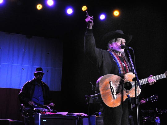 Willie Nelson  performs with his band  at the  Fontanel