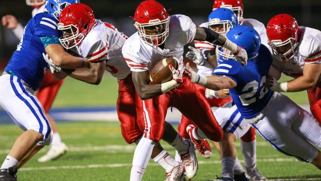 Orchard Lake St. Mary's Justin Myrick (3) breaks though the defensive line against Novi Detroit Catholic Central during a varsity football game at Catholic Central in Novi, Mich. on Friday, Oct. 9, 2015.