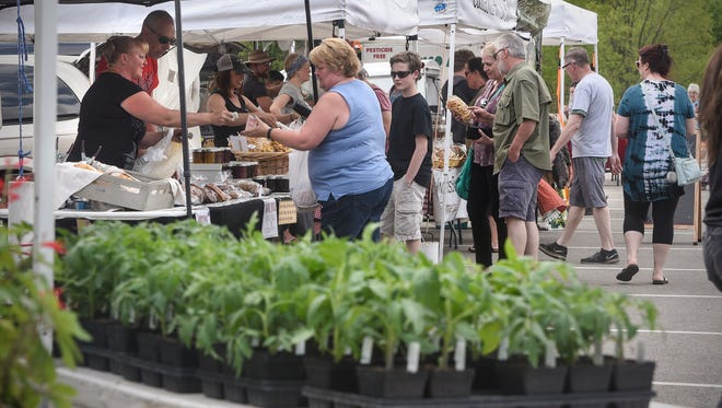 Plants and many other fresh items are on display Friday, May18, at the St. Joseph Farmers Market.