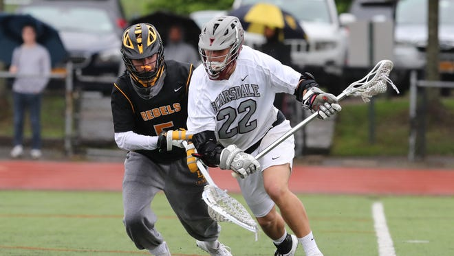 Lakeland/Panas goalie JP Walsh (5) works Slarsdale's Andrew Bernstein (22) behind the goal during the the boys lacrosse class A quarterfinal game at Scarsdale High School on Tuesday, May 22, 2018.