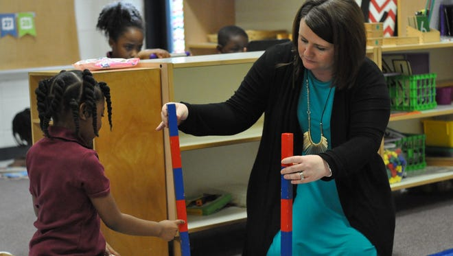 Pre-K and Kindergarten students in Monica Cox's classroom complete hands-on tasks incorporated through Montessori instruction offered at Rosenthal Elementary in Alexandria.