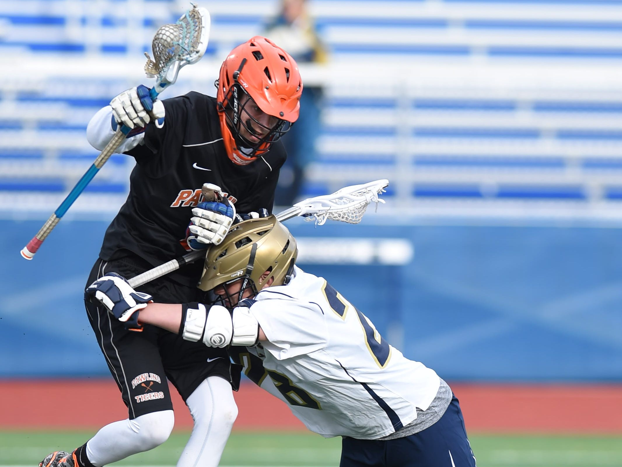 Lourdes' Adam Breault blocks on Pawling's James Comerford during Thursday's game at Lourdes.