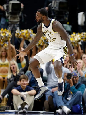 Indiana Pacers guard Lance Stephenson (1) reacts after a basket against the New York Knicks during the first half of an NBA basketball game in Indianapolis, Monday, Dec. 4, 2017