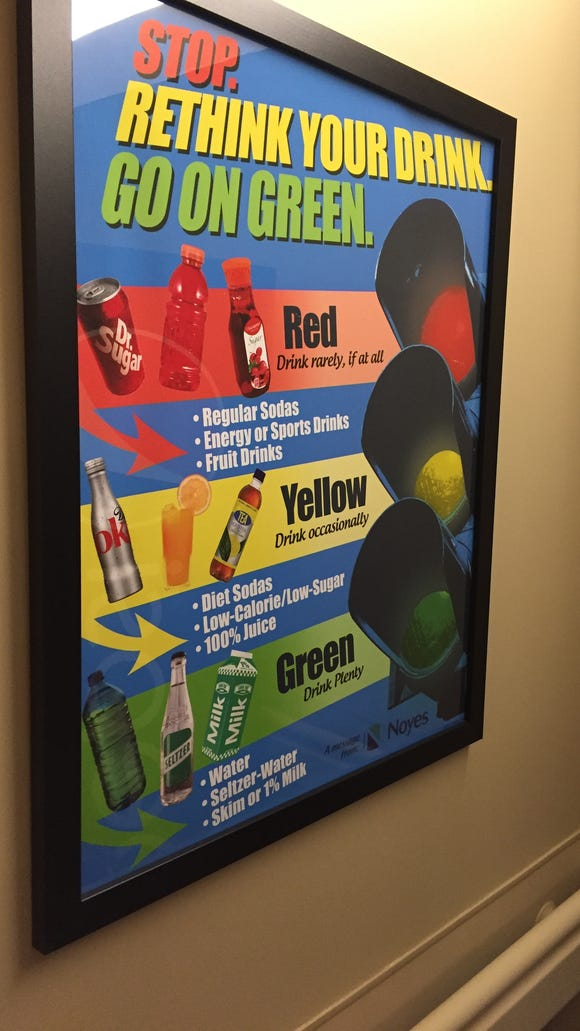 Sign next to a soda vending machine in a hospital waiting area urges consumers to think before selecting a beverage. Some hospitals have formal plans to help staff and visitors cut down on the amount of soda they drink.