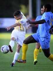 Forward Asmir Pervan (24) kicks past a Chattanooga Football Club defender during a game.