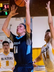 Redwood's Nathan Treece goes up for two against Golden