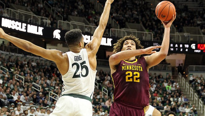 Minnesota center Reggie Lynch (22) is defended by Michigan State forward Kenny Goins (25) during the first half Wednesday at Breslin Center.