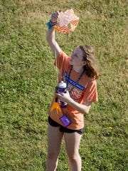 Leah Fredericks, 12, of Carmel, Ind., gathers another camper's rocket and parachute at the University of Evansville's Engineering Options for Girls camp for middle school girls Wednesday morning.