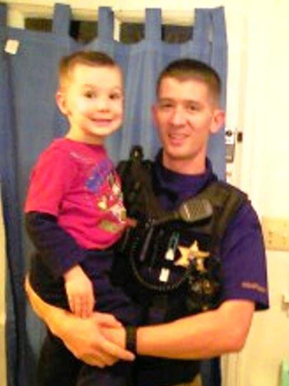 Cascade County Sheriff's Deputy Joseph Dunn with his