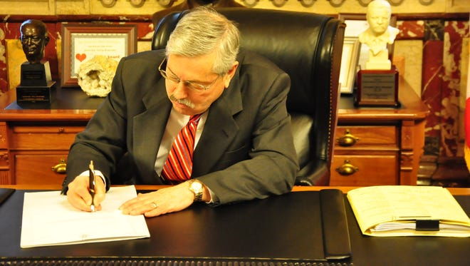 Iowa Gov. Terry Branstad signs into law Senate File 291, the collective bargaining reform bill.