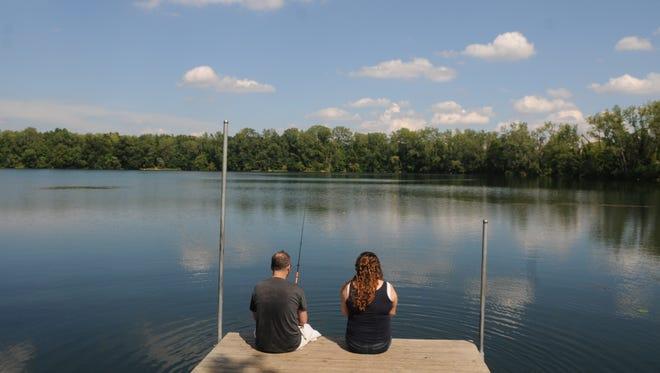 Fishing at woodland lake.