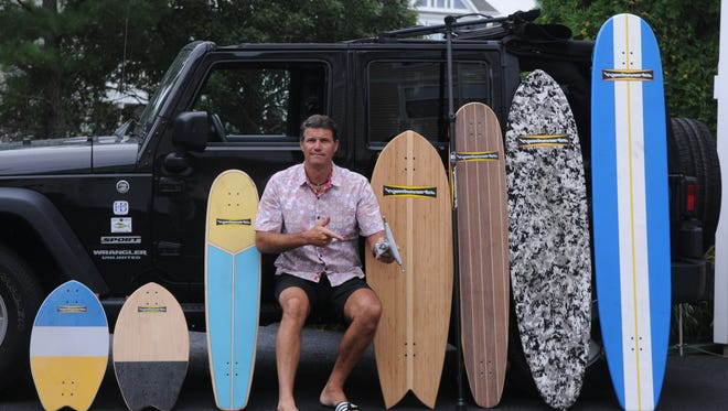 Don Sandusky poses with his hamboards on Aug. 7, 2017.