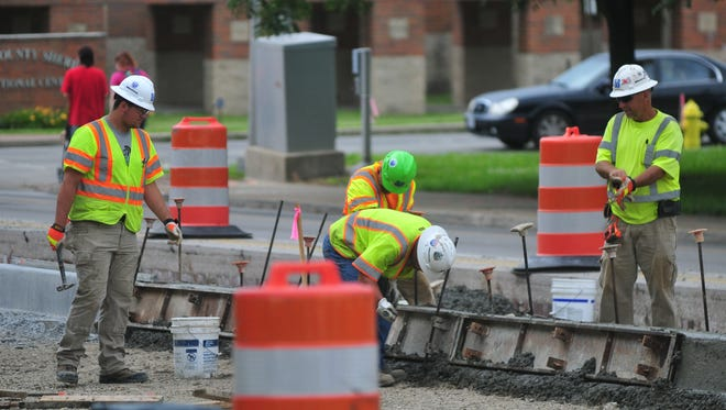 A crew from Milestone Contractors works Monday on the Stellar Streets project in downtown Richmond.