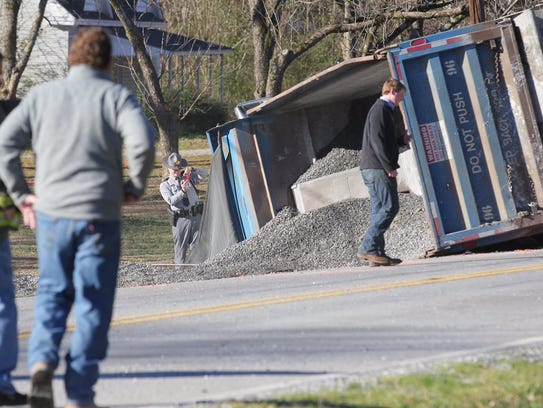 A gravel truck overturned on Whitehall Road in Anderson