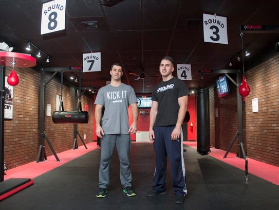9Round kickboxing gym franchise owner Guy Shaham, left, and trainer Jevareio Gasso in the gym.