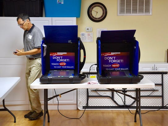 Early morning arrivals cast their vote in Anderson