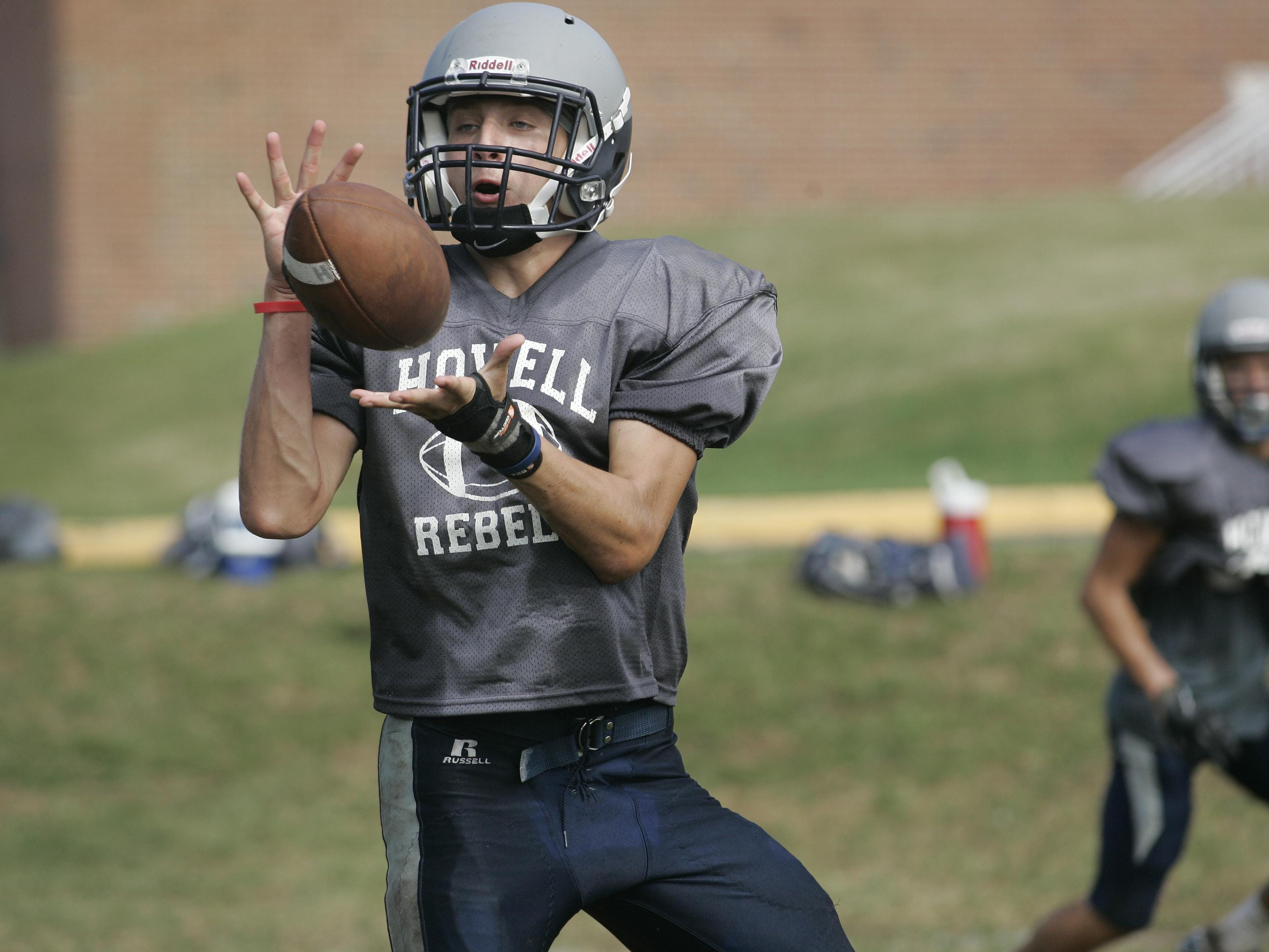 Howell wide receiver Nic Rossi hauls in a pass during practice.