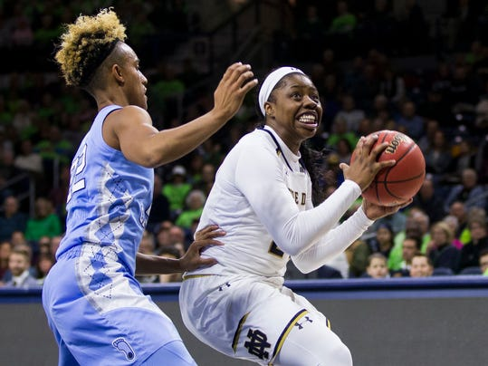 Notre Dame's Arike Ogunbowale, right, looks for a shot as North Carolina's Paris Kea (22) defends during the first half of an NCAA college basketball game Thursday, Feb. 1, 2018, in South Bend, Ind. (AP Photo/Robert Franklin)