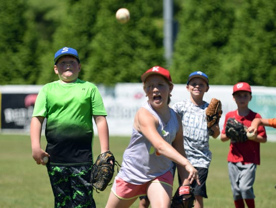 Ashley Critzer, 8, of Fishersville throws a pitch during