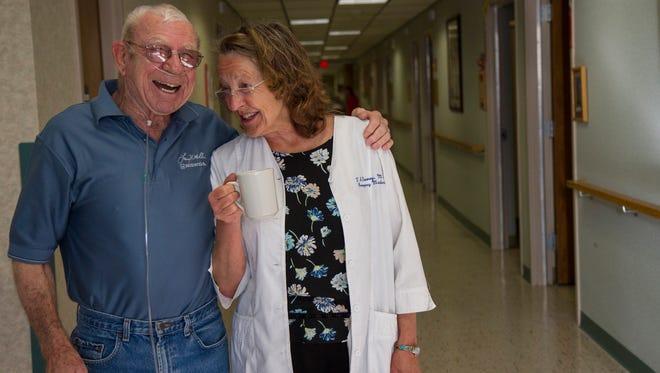 Dr. Teresa Denney and Teton Medical Center resident Dale Johnson share a laugh during Dr. Denney's morning rounds.