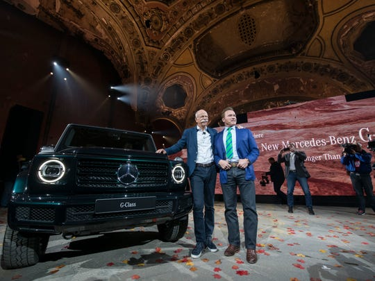 Dieter Zetsche, chairman of the board for Daimler AG, left, and Arnold Schwarzenegger, actor and former governor of California, pose for photos in front of the new Mercedes Benz refresh of the G-Class SUV.