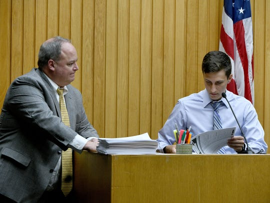 Noah Walton on the stand with Assistant District Attorney