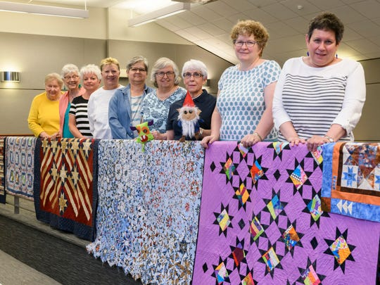 Members of the Farmington Community Library Quilters include (from left) Ruth Ann Carter,  Joyce Montante, Andrea Cushman, Letty Abraham, Dalphine Lamb, Esther Lacy, Susan Horner, group leader Lori Rhode, and Jan Jacobs.