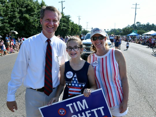 Tim Burchett with his wife, Kelly, and their daughter, Isabel in the Town of Farragut's 31st annual Independence Day Parade Wednesday, July 4, 2018.