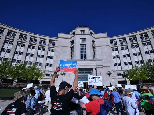 Supporters of an initiative to create an independent redistricting commission gather outside the Michigan Supreme Court on July 18, 2018