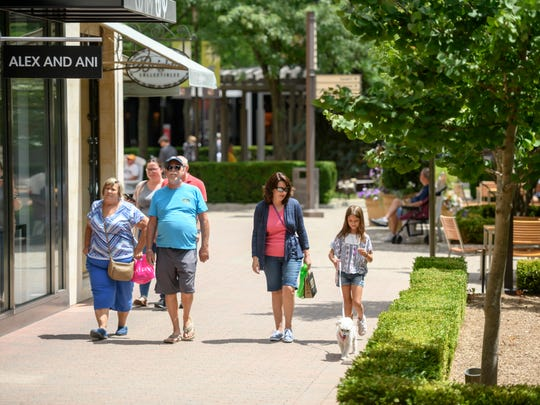 Shoppers enjoy a warm summer afternoon at the outdoor Partridge Creek Mall, in Clinton Two., July 18, 2018.