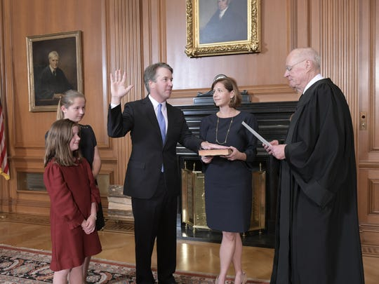 Justice Anthony M. Kennedy, (Retired) administers the Judicial Oath to Judge Brett M. Kavanaugh in the Justices' Conference Room, Supreme Court Building. Mrs. Ashley Kavanaugh holds the Bible, Oct. 6, 2018.