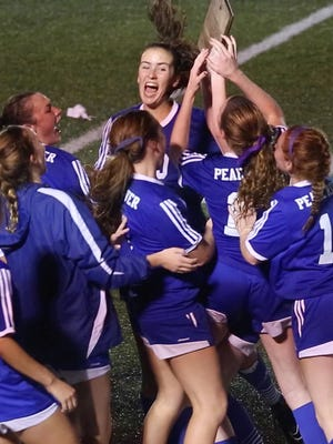 Pearl River players celebrate after defeating Somers 2-1 in the girls soccer Section 1 Class AA  championship game at Yorktown High School Oct. 30, 2016.