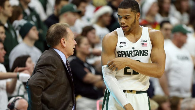 Michigan State Spartans guard Miles Bridges (22) talks to Michigan State Spartans head coach Tom Izzo during the first half of a game against the Southern Utah Thunderbirds at Jack Breslin Student Events Center.