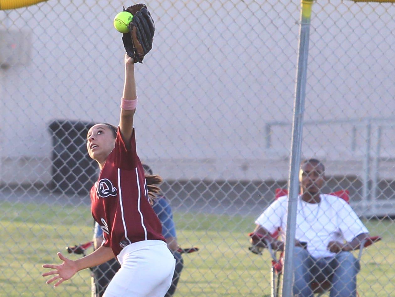 Kendyl Scott of La Quinta High School catches a fly ball hit by Janay Garcia of Indio High School. La Quinta won the game 3-2. Wade Byars \The Desert Sun