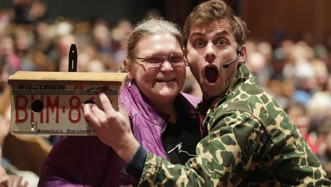 Comedian Charlie Berens poses with the woman who paid $300 for a birdhouse he auctioned off during his sold-out show in March 2018 at the Weidner Center. The money was donated to the Wounded Warrior Project.