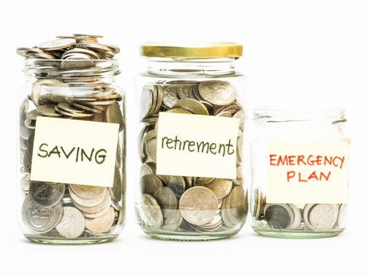 Coins in jar with saving, retirement and emergency plan labels