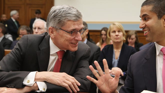 Federal Communications Commission Chairman Tom Wheeler (L) and FCC Commissioner Ajit Pai visit before testifying to the House Judiciary Committee about Internet regulation in the Rayburn House Office Building on Capitol Hill March 25, 2015 in Washington, DC. Wheeler faced a tough line of questioning from the committee's Republicans about the FCC's recent move to regulate broadband Internet service like a utility using Title II of the Communications Act.