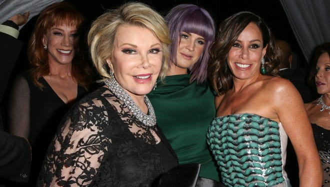 Joan Rivers and daughter Melissa Rivers, with Kathy Griffin and Kelly Osbourne, at a pre-Gammy gala in Beverly Hills, in January 2014.