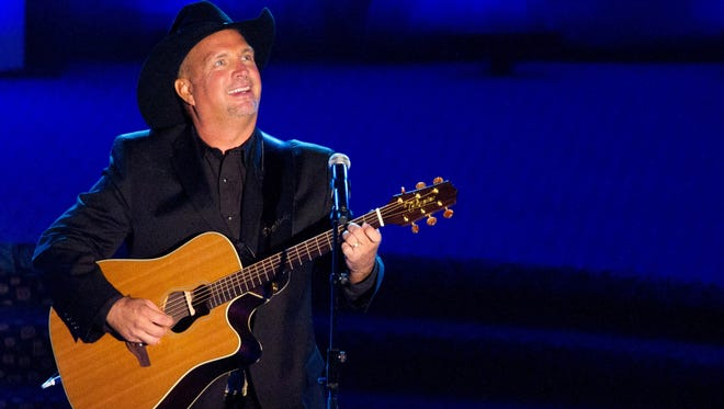 FILE - This June 16, 2011 file photo shows inductee Garth Brooks performs onstage at the 42nd Annual Songwriters Hall of Fame Awards in New York.