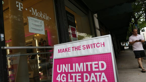 A T-Mobile store is seen on June 4, 2015 in Miami, Fla.   After the government nixed AT&TÕs attempt to buy the company in 2011, T-Mobile led the way in many consumer-friendly changes, such as ditching two-year contracts and bringing back unlimited data plans. Consumers are paying less for cellphone service, thanks to T-MobileÕs influence on the industry and the resultant price wars.
