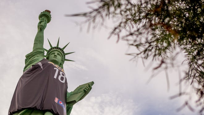 A replica of the Statue of Liberty on July 8, 2018, outside of the New York, New York Hotel and Casino in Las Vegas, Nevada. The United States Postal Service will pay artist, Robert S. Davidson, $3.5 million after using an image of his sculpture instead of the national landmark in New York.