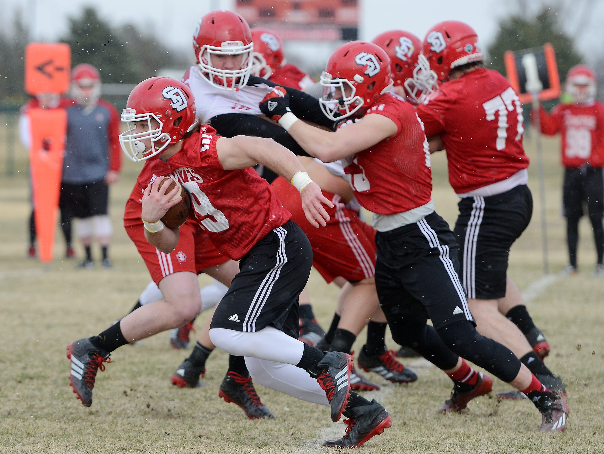Runningback, Shay Bratland carries the ball during