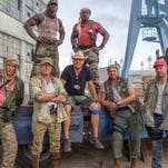 Staggered from left to right: Dolph Lundgren, Terry Crews, Sylvester Stallone, Patrick Hughes, Wesley Snipes, Randy Couture, and Jason Statham on the set of the motion picture 'The Expendables 3.'