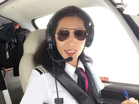 Stuart flight instructor Julie Wang flies over the
