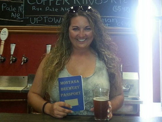 Miranda Hackman poses with her completed Montana Brewery