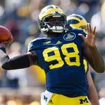 Wolverines quarterback Devin Gardner warms up before U-M's 30-14 loss to Minnesota Saturday in Ann Arbor.