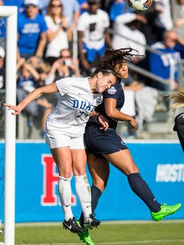 Ben McKeown/AP Raquel Rodriguez, right, collides with Duke's Taylor Racioppi on a header during the Women's College Cup final in Cary, N.C.