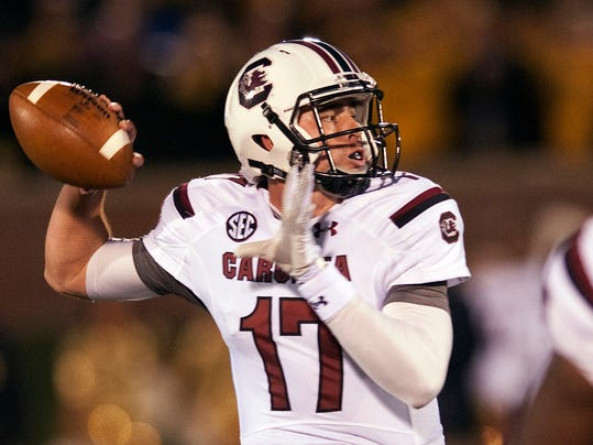 FILe - In this Oct. 26, 2013 file photo, South Carolina quarterback Dylan Thompson throws a pass during the first quarter of an NCAA college football game against Missouri, in Columbia, Mo. Thompson's made a college career out of a few big moments that South Carolina fans won't ever forget. Now, Thompson's under center from the start and he understands that what he did before won't matter much if he can't succeed as starter.(AP Photo/L.G. Patterson, File)