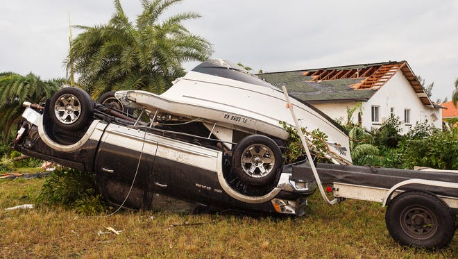 Scenes on Sunday of the aftermath of a tornado that struck several neighborhoods in Cape Coral late Saturday.